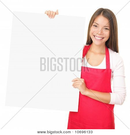 Sales Clerk Showing Blank Sign