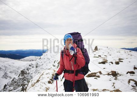 A Girl Drinks Water At The Top Of High Mountains.