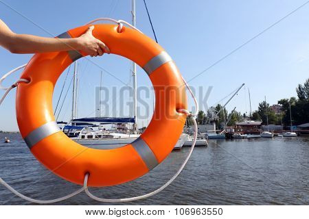 Hands hold a life buoy
