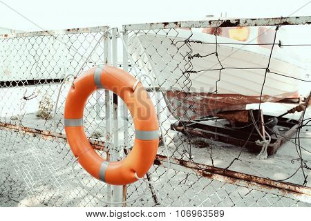 A life buoy hangs on the pier's fence