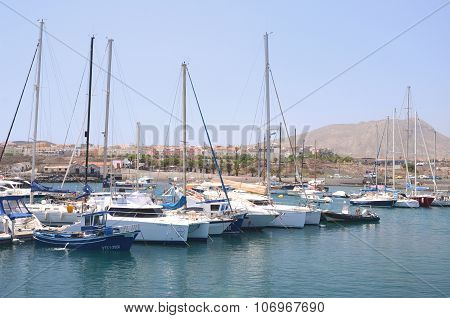 Boats and yachts in fishing harbor in Las Galletas on Tenerife