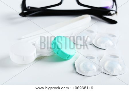 Contact Lenses In Container With Solution On White Background