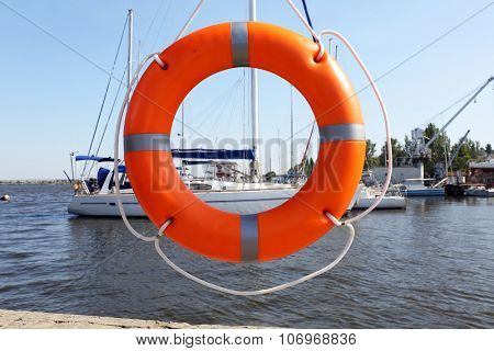 A life buoy on the sea background