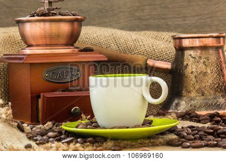 Fresh Coffee With Coffee Pot And Wooden Grinder At Roasted Bio Coffee Beans