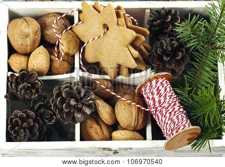 Christmas Cookies, Walnuts, Nuts And Pine Cones In Wooden Box. Top View