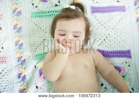 A cute little baby girl suck thumb