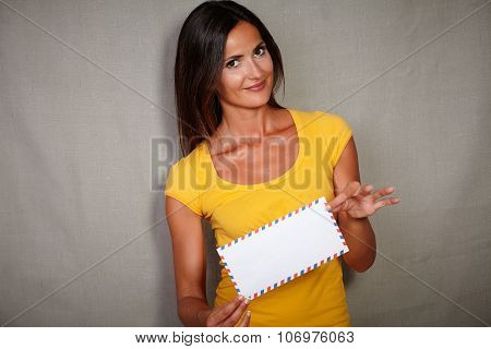 Young Lady Holding Mail While Looking At Camera