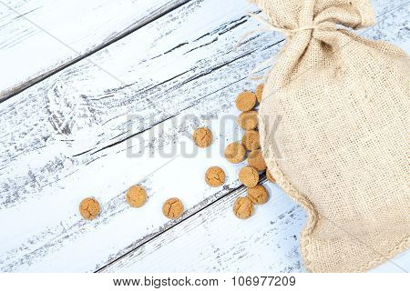 Dutch Candy Pepernoot With Jute Bag On White Blue Wooden Background