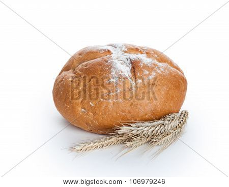 Homemade Whole Round Bread And Stalks Of Wheat