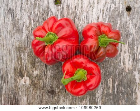 red paprika on a wooden table