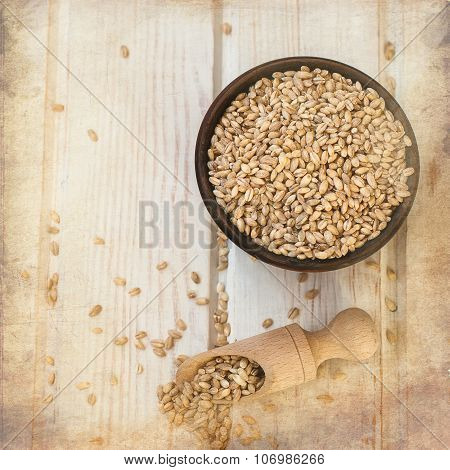 Raw Pearl Barley In A Bowl And Wooden Spoon