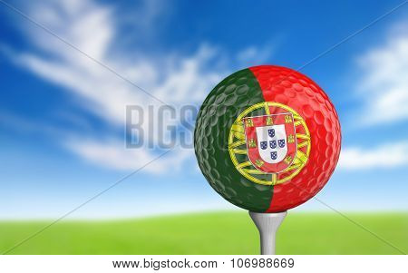Golf ball with Portugal flag colors sitting on a tee