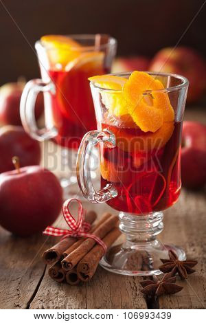glass of mulled wine with orange and spices, winter drink