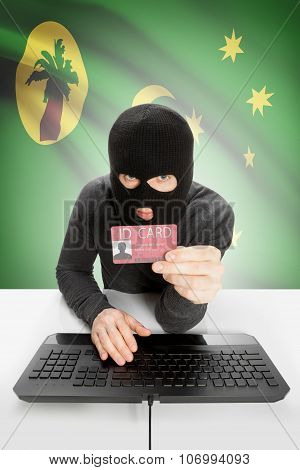 Hacker With Flag On Background Holding Id Card In Hand - Cocos (keeling) Islands