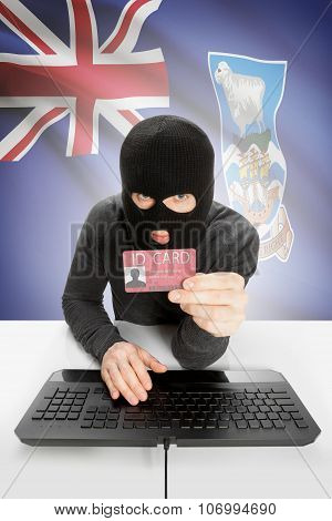 Hacker With Flag On Background Holding Id Card In Hand - Falkland Islands