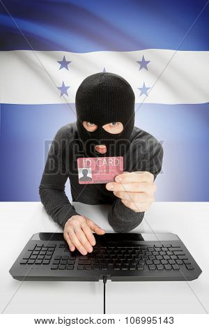 Hacker With Flag On Background Holding Id Card In Hand - Honduras