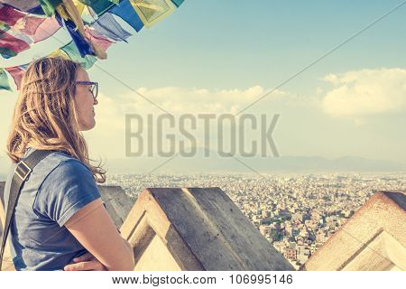Young woman enjoying the evening view of a city.
