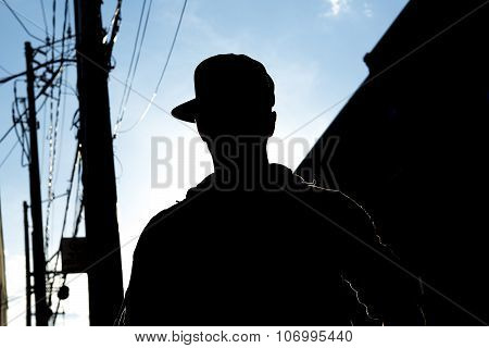 Silhouette of A sexy man outside in a city street