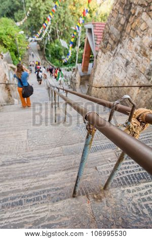 Descending staircase with rail.