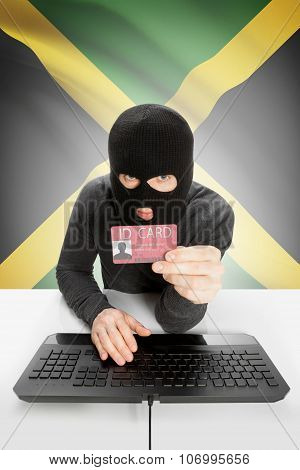 Hacker With Flag On Background Holding Id Card In Hand - Jamaica