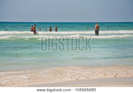 People play in the water on the paradise beach