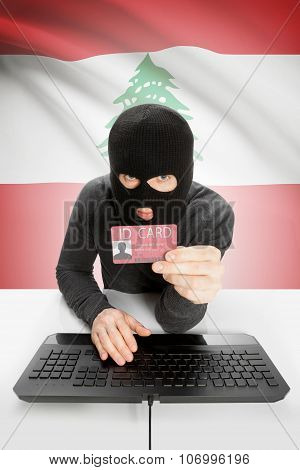 Hacker With Flag On Background Holding Id Card In Hand - Lebanon