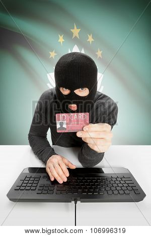 Hacker With Flag On Background Holding Id Card In Hand - Macau