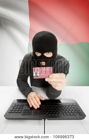 Hacker With Flag On Background Holding Id Card In Hand - Madagascar