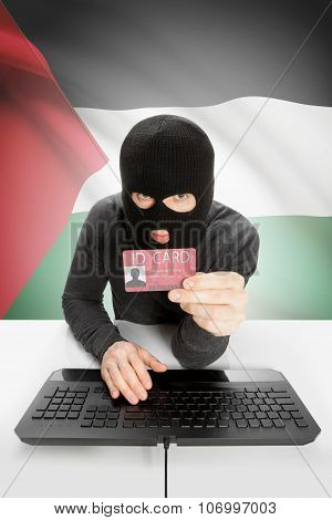 Hacker With Flag On Background Holding Id Card In Hand - Palestine