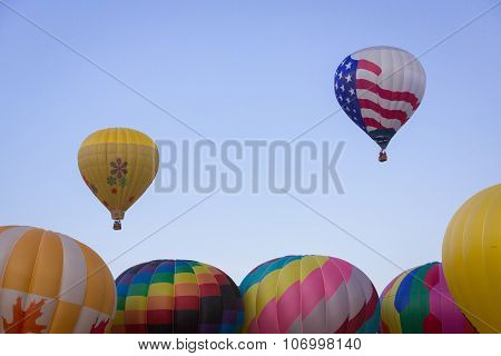 Two Hot Air Balloons above Others
