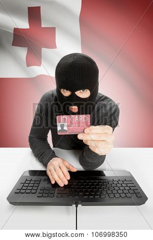 Hacker With Flag On Background Holding Id Card In Hand - Tonga