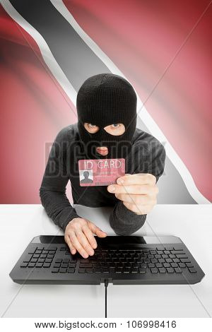Hacker With Flag On Background Holding Id Card In Hand - Trinidad And Tobago