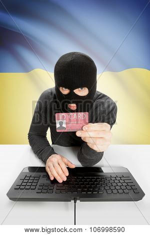 Hacker With Flag On Background Holding Id Card In Hand - Ukraine