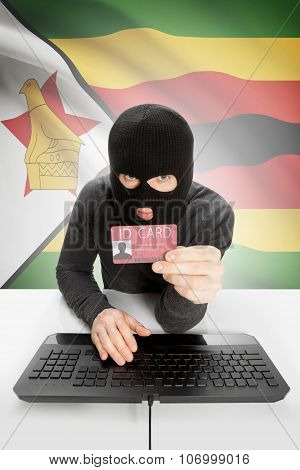 Hacker With Flag On Background Holding Id Card In Hand - Zimbabwe