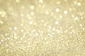 Silver and golden glittering Christmas lights. Gold sparkling Blurred abstract background poster