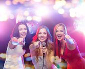 party, holidays, nightlife, entertainment and people concept - concept - happy women with microphone poster