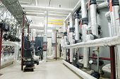 stock photo of thermos  - Interior of independent modern gas boiler room with manometers valves pumps and thermo - JPG
