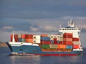 image of container ship  - a colourful containership on the approach into dublin bay - JPG