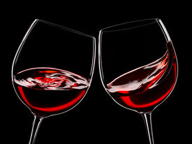 pic of red wine  - two glasses of red wine isolated over black - JPG