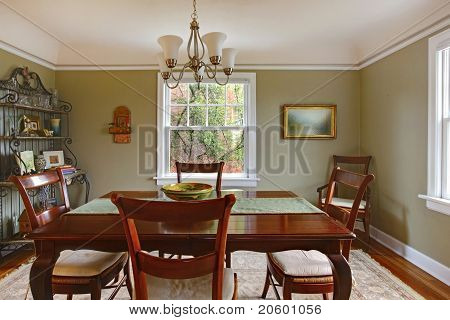Green Dining Room With Mahogany Furniture