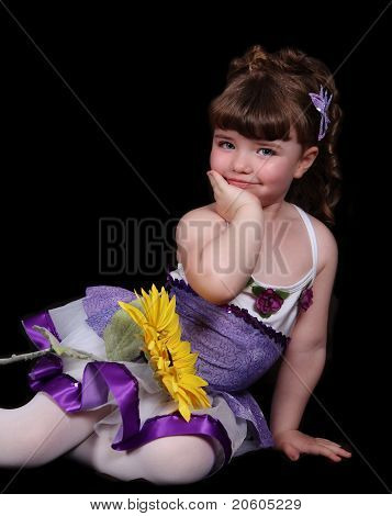 Sweet Little Girl In Purple And White Ballet Outfit Sitting With