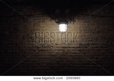 Isolated Lamp Lighting Spot On Brick Wall