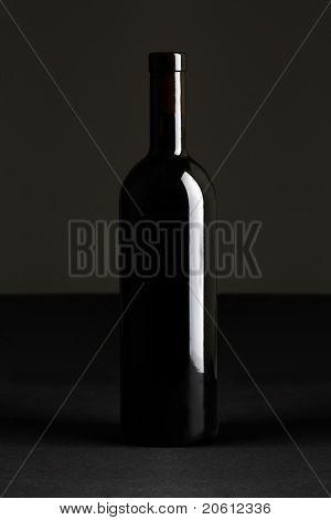 bottle of wine on dark background