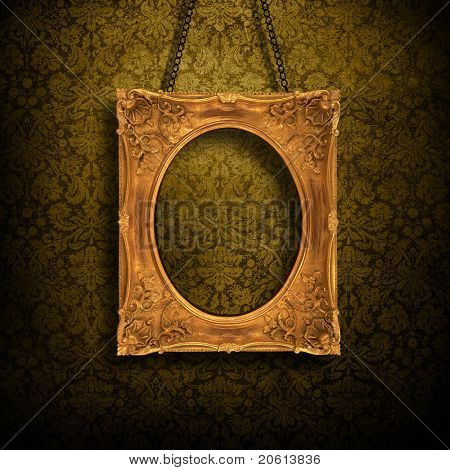 Grungy antique wallpaper background with golden frame