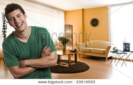 Happy young man at his apartment