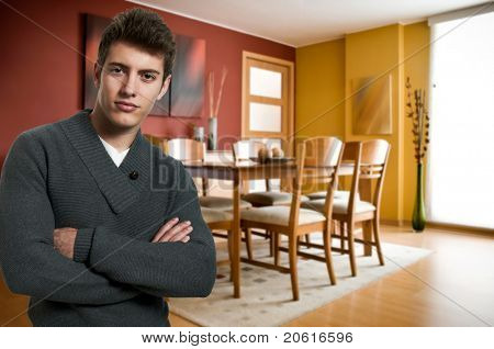 Young confident man at his apartment