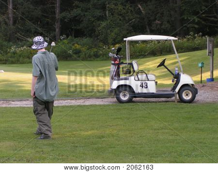 Golfer & Golf Cart