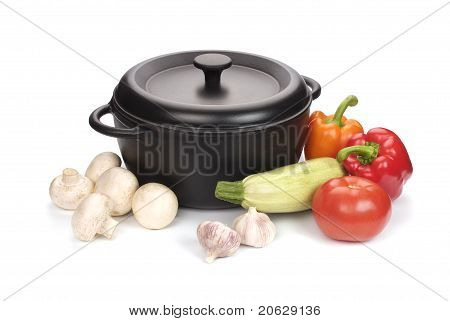 Black Cast-iron Cauldron With Vegetables