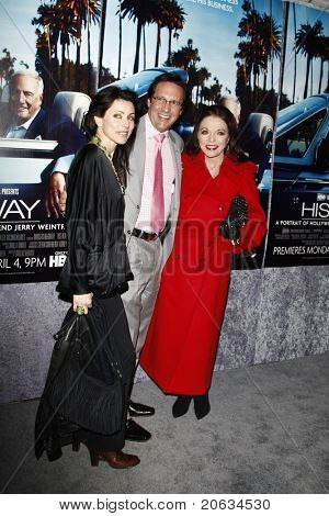 LOS ANGELES - MAR 22:  Joan Collins, Percy Gibson and her daughter in law arrive at the Los Angeles HBO Premiere of 'His Way' at Paramount Studios in Los Angeles, California on March 22, 2011.