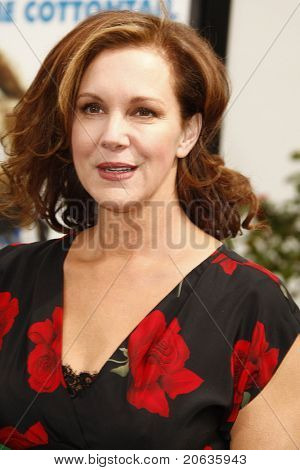 LOS ANGELES - MAR 27:  Elizabeth Perkins arrives at the World Premiere of 'HOP' held at Universal Studios Hollywood on March 27, 2011 in Los Angeles, California